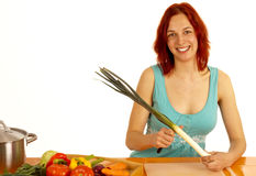 Leek. A young woman cuts a leek Royalty Free Stock Photo