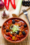 Leek and black olives stew.  royalty free stock image