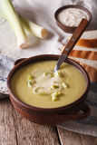 Leek cream soup in bowl close-up on the table. vertical Stock Image