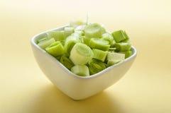 Leek cut. In white bowl Stock Image