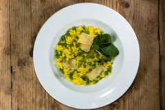 Leek, garden pea and saffron risotto looking down on plate Stock Image