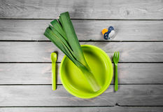 Leek on a kids plate. Healthy green food for kids Royalty Free Stock Photo