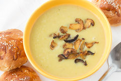 Leek mashed soup with fried sliced mushrooms royalty free stock image