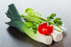 Leek, parsley and tomato Stock Photos