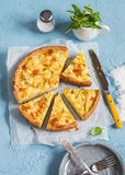 Leek, potato and cheese pie on a blue background Royalty Free Stock Image