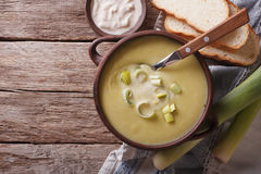 Leek puree soup with sour cream on the table. horizontal top vie Royalty Free Stock Photo
