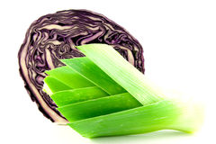 Leek and Red cabbage. Red cabbage cut in half with a leek on a white background Royalty Free Stock Photography