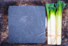 Leek on rustic background. royalty free stock images
