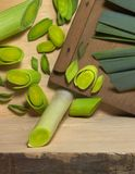 Leek and slicer Royalty Free Stock Image