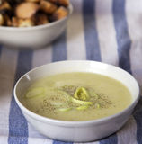 Leek soup. Bown on a blue and white tablecloth Royalty Free Stock Image