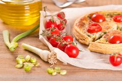 Leek and tomato quiche. royalty free stock photography
