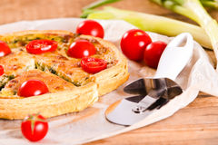 Leek and tomato quiche. Royalty Free Stock Image