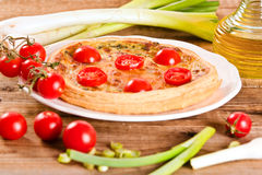 Leek and tomato quiche. stock photography