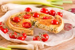 Leek and tomato quiche. stock image