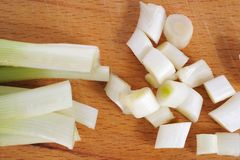 Leeks. On a wooden board royalty free stock photography