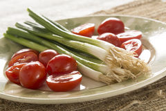 Leeks and Cherry Tomatoes Royalty Free Stock Photography