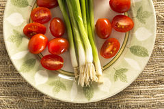 Leeks and Cherry Tomatoes Stock Photos