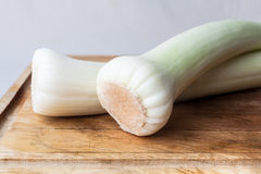 Leeks on cutting board Royalty Free Stock Photo