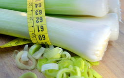 Leeks tied with tape measure Royalty Free Stock Photo