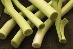 Leeks on a wooden table Stock Photo