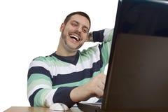 leende för lyckabärbar datorman Arkivbilder