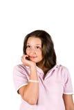 Leende och tänka för tonåring Royaltyfri Bild