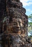 Leendeframsidan av tornet i den Bayon templet Royaltyfria Foton