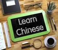 Leer Chinese Met de hand geschreven op Klein Bord 3d Royalty-vrije Stock Foto's