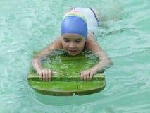 Leer te zwemmen Stock Foto's