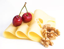 Leerdammer cheese slices with nuts and cherries Stock Photography