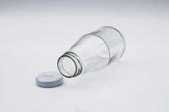 Leere farblose Glasflasche Stockfotos