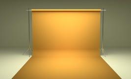 Leere Fotografiestudiohintergrund-Gelbschablone Stockfoto