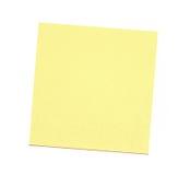 Leere gelbe klebrige Anmerkung über weißen Hintergrund Stockbilder