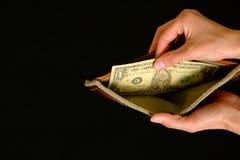 Leere Geldbörse mit einem Dollar auf schwarzem Hintergrund Lizenzfreies Stockbild