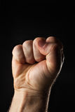 Leere geschlossene männliche Hand Stockfoto