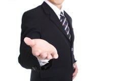 Leere Hand des Geschäftsmanngebrauches, damit Sie etwas für Show hinzufügen Lizenzfreies Stockfoto