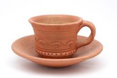 Leere Kaffeetasse auf einer Platte Stockfotografie