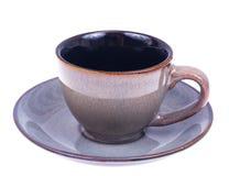 Leere Kaffeetasse und untertasse auf weißem Hintergrund Lizenzfreie Stockfotos