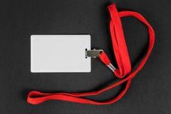 Leere Karte Identifikation/Ikone mit einem orange Gurt auf einem schwarzen Hintergrund Lizenzfreie Stockfotografie
