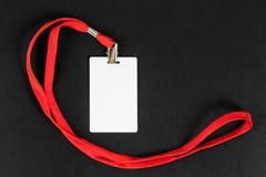 Leere Karte Identifikation/Ikone mit einem orange Gurt auf einem schwarzen Hintergrund Lizenzfreie Stockbilder