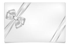 Leere Papierkarte mit glänzendem silbernem Bogen Stockbild