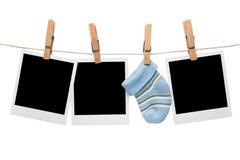 Leere polaroidbabysocke Stockbilder