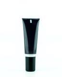 Leere schwarze Sahnerohr- oder Kosmetikflasche lokalisiert auf weißem Hintergrund Stockbilder