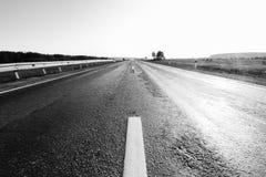 Leere Straße mit geringfügiger Bewegungsunschärfe Lizenzfreies Stockfoto