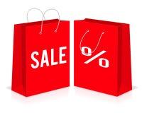 Leere Taschen des roten Einkaufspapiers mit Prozent- und Verkaufszeichen Auch im corel abgehobenen Betrag Lizenzfreies Stockbild