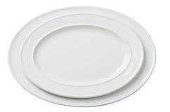 Leere weiße ovale Platte zwei lokalisiert Stockbild
