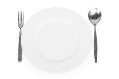 Leere weiße Platte, Gabel und Löffel Stockfotos