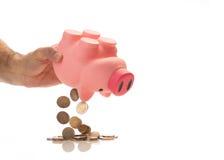 Leeren von Sparschwein mit Euro-` s lizenzfreie stockfotografie