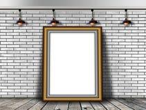 Leerer Bilderrahmen auf der Backsteinmauer Lizenzfreies Stockbild