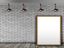 Leerer Bilderrahmen auf der Backsteinmauer Stockfotos